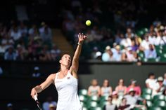 Jelena Jankovic serves during her Third round match. Florian Eisele/AELTC Wimbledon 2015