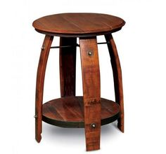 What a perfectend table to add wine country charm to any room. Crafted from durable white oak wine barrels, thisRound Stave End Table features a rough-sawn pi