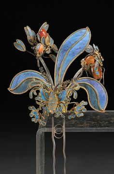 China | Kingfisher feather hairpin; in the form of a flowering plant with kingfisher feathers and set with carnelians | ca. 19th century | 711$ ~ sold (Dec '10)