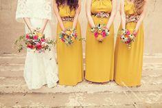 Bride-in-lace-wedding-dress-with-bridesmaids-in-mustard.original