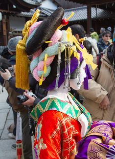 A geiko dressed as a kabuki actor.  She is dressed as an oiran.