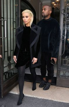 In sync: The reality star was closely followed by her doting husband as she made her debut - he matched her look in black