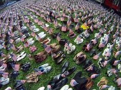 A display of 2,974 pairs of shoes was set up outside the Ocean Grove Auditorium Friday by radio station 99.1 Star FM to remember those killed on Sept. 11, 2001.