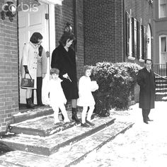 Jacqueline Bouvier Kennedy and Children Leaving for Holiday Trip  Mrs. Jacqueline Kennedy, accompanied by her children, John Jr., and Caroline, emerge from their home, en route to Andrews Air Force Base. From there they were to fly to Palm Beach, Florida to spend the holidays. The woman at the left is unidentified.  December 01, 1963.❤❤❤❤   http://en.wikipedia.org/wiki/Jacqueline_Kennedy_Onassis  http://en.wikipedia.org/wiki/Caroline_Kennedy   http://en.wikipedia.org/wiki/John_F._Kennedy,_Jr