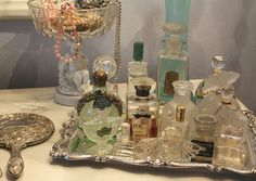 I love a vanity filled with seductive bottles and fripperies and cosmetics!  From http://www.flickr.com/photos/23264080@N00/