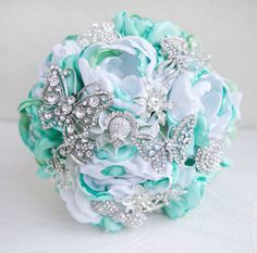 Another pic for inspiration, mint green bouquet accented with jeweled silver butterflies.