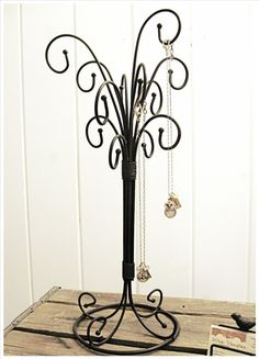 @WeCanDoItWeddings Kirk What do you think about using something like this as a centerpiece and hanging ribbons or flowers from it? Selma Curly Wrought Iron necklace jewelry tree by selinabeadsnbits