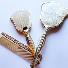 This is a three piece gold plated vanity set. The set includes a brush, comb and mirror (glass is missing). - Online Store Powered by Storenvy Vintage Shabby Chic, Vanity Set, Indie Brands, Stuff To Buy, Mirror Glass, Dressing Table, Small Businesses, Random Things, Purses