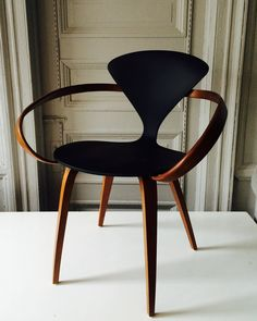 Form- Black & wood cherner armchair. The way that the armrests wind around give the chair a feeling of depth.