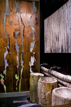 Striking wall panelling - teak root filled with resin...a very dramatic addition to a masculine room.