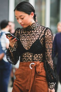 Margaret Zhang's top is a little romantic, and a little risqué. #refinery29 http://www.refinery29.com/2015/09/93788/ny-fashion-week-spring-2016-street-style-pictures#slide-6