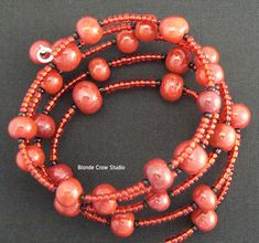Maria Jam Brown's faux polished cinnabar beads- made from translucent polymer clay, alcohol inks and mica powders