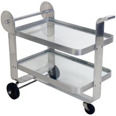 Streamlined Aluminum Art Deco Bar Cart | From a unique collection of antique and modern bar carts at https://www.1stdibs.com/furniture/tables/bar-carts/