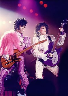 Prince & The Revolution - Purple Rain Tour 1985 in Purple Lights with Wendy Melvoin (Photoshop CC '014 Upsampled to 1600 pixel height Test - Looks good! This is going to work for all those crummy old tiny scans fams did in the last decade. We're going for quality in this pinboard! Even the small preview looks HD! - Modernaire 2014)