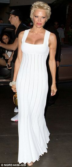 Chic: The former Baywatch star wore a white dress that showed off her toned arms... http://dailym.ai/P2U0ok#i-a9240e67