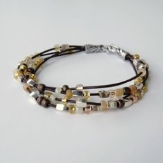 Make your own easy and stylish bracelet from leather cord, glass and metal beads.  Full tutorial.