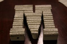 Letters covered in book pages. Another potential diy gift for my dorky sister in law