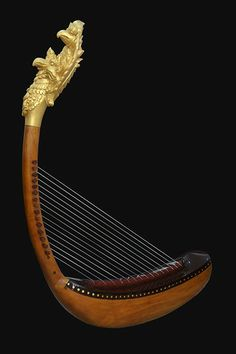 The Pin is a #Cambodian #harp which creation dates back to #Angkorian times. Any knowledge about was lost until 2013, when French ehtnomusicologist Patrick Kersalé rebuilt the Pin along with other lost Angkorian instruments after 20 years of research. Not Samphos, a scholar from arts organization Cambodian Living Arts, will perform the Pin on Apsara TV on June 22 9-10am! Photo: (c) Patrick Kersalé