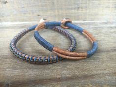 This simple but stylish bracelet set is a great choice from my Guys collection. Both bracelets are included in this listing. Made from two strips of 3mm natural leather cord, wrapped in sections with faded blue waxed linen. The other bracelet wrapped with gunmetal beads. Stainless steel nut and leather loop closure. These bracelets will add style to any guys wardrobe.  Each bracelet is custom made to fit your wrist, so I will need your true wrist size. I will add extra length for that…