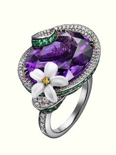 """Limelight """"Blue Moon"""" cocktail inspiration ring in 18K white gold set with one oval-cut amethyst, 100 round emeralds, 296 brilliant-cut diamonds, one round yellow sapphire, and sculpted white chalcedony."""