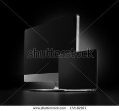 two computers with black screen on a dark background - stock photo