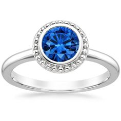 18K White Gold Sapphire Juliet Ring, top view. The interplay of a contemporary bezel setting and a halo of precious metal beads creates a gorgeous and distinctive effect in this artisan-inspired engagement ring.
