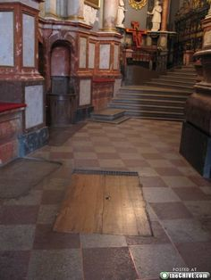 Normally covered with a carpet, here revealed is a secret passage in a great castle