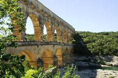 Pont du Gard, en France... cliff jumping, picnicking, and swimming upstream - so many memories!