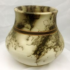 Original, hand thrown horse hair pottery with copper band inlay.