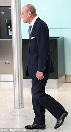 In the airport: The Duke of Edinburgh inspects the new Terminal 2 23 June 2014 http://www.hearingaidscentral.com/Hearing-Aid-Options_ep_96.html