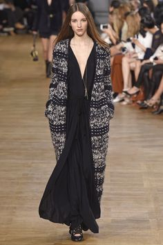 For fall, Chloé's free spirit wore rich hippie dresses and long gentlemen's coats. [Photo by Giovanni Giannoni]