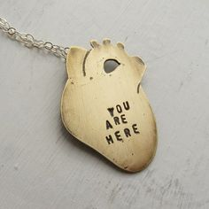 i need this in my life! Anatomical Heart Necklace You Are Here Brass by HouseThatCrowBuilt, $35.00
