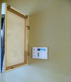 Gonna use this for my thermostat. How To Hide an Alarm Control Panel with a canvas on a hinge