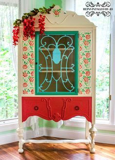 """Reinvintaged by Jo handpainted antique china cabinet makeover. Multiple different colors: Tan background, shabby chic rose pink drawer, blue and green door. Royal Design Studio """"Spring Rose Blossoms"""" stencil on the front.     #reinvintagedbyjo #handpainted #turquoise #diy #roses #flowers #paintedfurniture #glamorous #glam #dreamhome #stencils #shabbychic #shabbyrose #makeover #royaldesignstudio"""