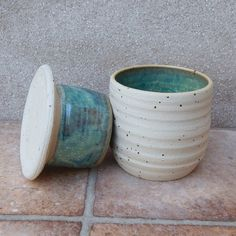This useful crock is designed to keep your butter fresh and soft at room temperature. The lid has a hollow flange where you should pack the butter in. This lid is turned upside down while serving butter, but kept in the pot when not. Butter Bell, Butter Crock, Magical Home, Thrown Pottery, Pottery Wheel, Contemporary Ceramics, Stoneware Clay, Ceramic Pottery, Arts And Crafts