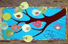 Way a fun start of a new year of preschool bulletin board with each of your new kiddos being a bird -- love the different scrapbook patterned paper!