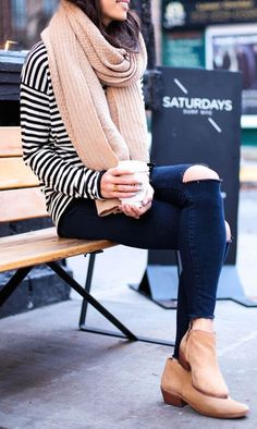 Black + white tee, black ripped jeans, camel booties, and a camel scarf.