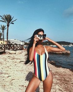 How cute is this?! We love this swimsuit and also how perfect is the location! We would love to be sipping cocktails on the beach right now!