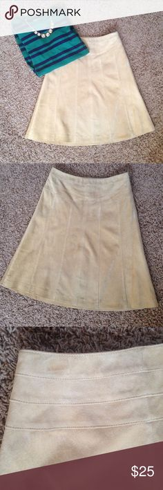 LOFT 100% suede leather skirt 100% suede leather a-line skirt from Ann Taylor Loft. Size: 0. Color: tan. Awesome skirt, lined, panel detail in front. Some wear on the back top left hem and front bottom right (shown) otherwise in great used condition. Perfect silhouette for this season! Length approx 21.5 inches. Top is also available. LOFT Skirts A-Line or Full