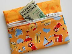 Snap Trap Lil' Kids Wallet tutorial.  Uses pieces of a tape measure.  Very clever!