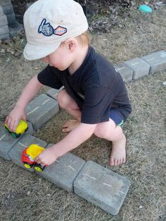 Outdoor Roads... love this! Need to get a few odd pavers or bricks for the kids to play/build with!