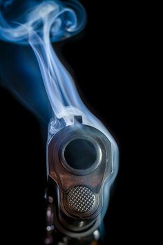 pretty, but not particularly realistic. guns don't generally smoke like that. hello photoshop...