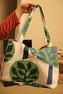 Ikea fabric into big diaper bag. Love the exterior pockets.
