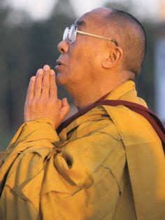 The Dalai Lama Prays During a Ceremony