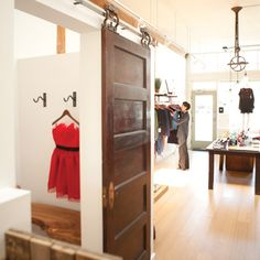 What a cool sliding barn door on the dressing room.  Seattle Magazine | Shopping/Fashion and Style | Clothing: New Boutiques and Vintage