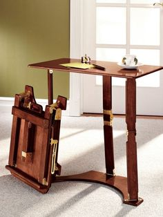 Versatile folding desk makes the perfect laptop table for your family room or bedroom. Use daily as a writing desk, then fold & store under the sofa!