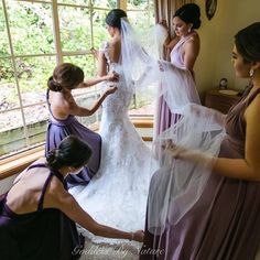 Love this amazing photo of beautiful bride @malteser86 with her bridesmaids dressing her on the day. Her bridal party looks gorgeous in their mismatch award winning Goddess By Nature signature multiway ballgowns in purples & pinks hues   Ela Studios  Stockist Just Bridesmaids and Formals  www.goddessbynature.com  #goddessbynature #goddessbynaturebridesmaids #ballgown #multiwaydress #wrapdress #infinitydress #convertibledress #weddingphoto #bride #weddinggown #weddingdress #bridesmaids