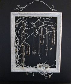 """Could make this with some 20 gauge wire and an old frame...maybe even put a linen backing on it and use the free space for smaller pieces."""