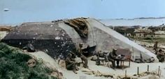 E-1 Beach Exit, Easy Red, Omaha Beach, June 7, 1944. This bunker was the 1st Danger Forward CP in Europe, but Maj Gen Huebner only stayed two hours, and displaced it further inland, up the bluffs in a field. The panel on left indicates this 2nd CP.