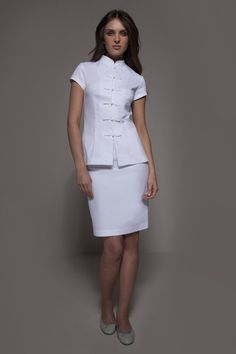 A combination of traditional Asian look & chic Prêt-à-Porter, the Shanghai & Manhattan is a couture spa uniform that personifies elegance and freshness. Salon Uniform, Spa Uniform, Beauty Uniforms, Scrubs Outfit, Medical Uniforms, Uniform Design, Nursing Dress, Look Chic, White Skirts